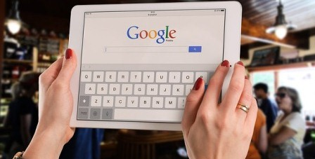 A tablet whose scree displays the Google search window