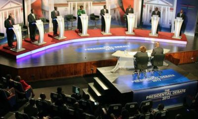 Presidential debate podium anf the 2013 Presidential candidates