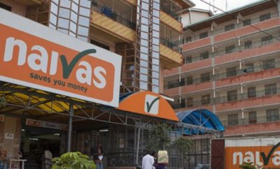 Navias Supermarket logo hang on a building