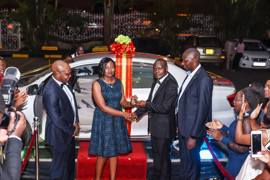 Joseph Gitonga, Head of Sales & Marketing, Username Investments awarding the grand prize winner of the day.