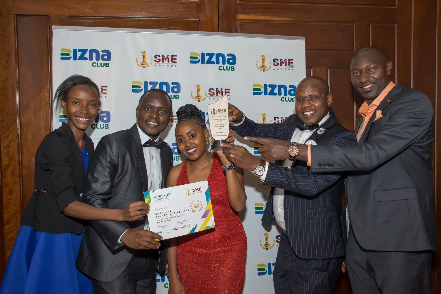 Username Investment Ltd. Team holding The Real Estate Company of the Year trophy won at the 2019 Bizna SME Awards